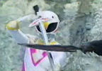 Pink Ranger blocks sword